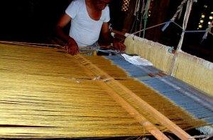 Master Weaver Setting the Loom